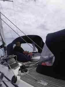 Bill reading in the forward cockpit